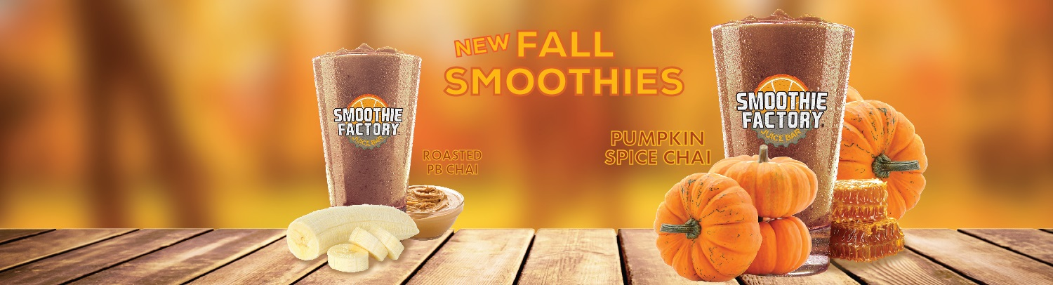 picture of our new fall smoothies, roasted pb chai and pumpkin spice chai, with pumpkins, bananas, peanut butter and honey, on a wodden table